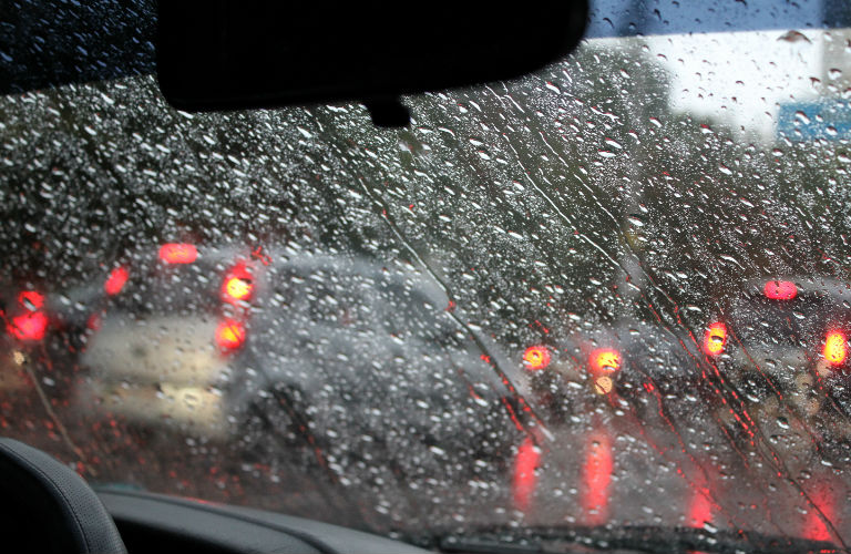 View through a rain-covered windshield.