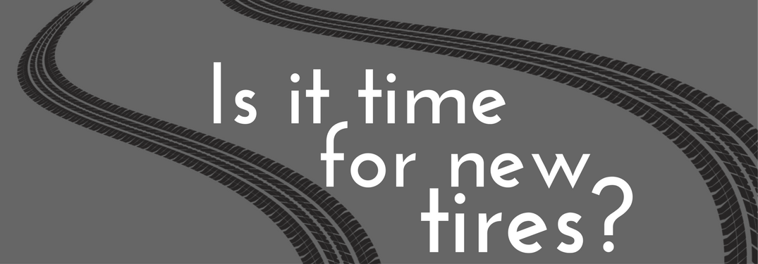 """""""Is it time for new tires?"""" written in between tire tracks on gray background"""