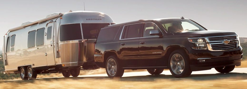 2019 Chevy Suburban black side view with trailer