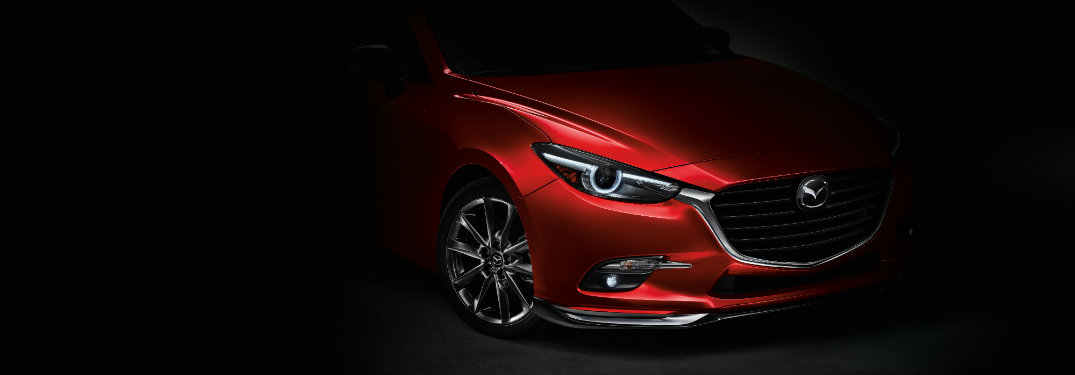 red mazda3 coming out of shadows