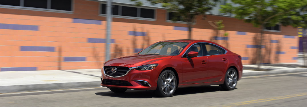 red mazda6 driving