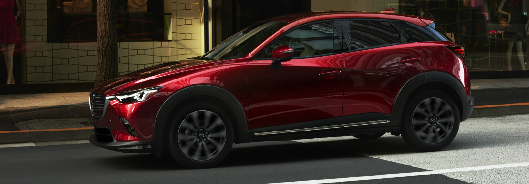 red mazda cx-3 on road