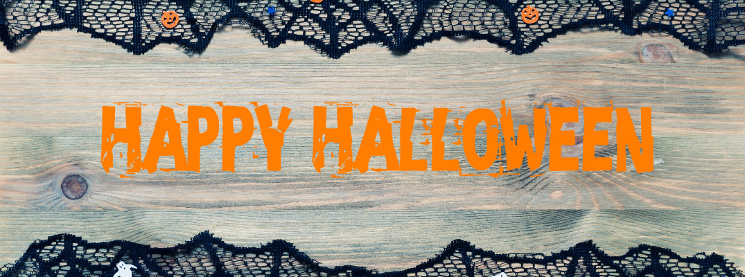 Orange happy halloween text on a wood background with fake black cobwebs