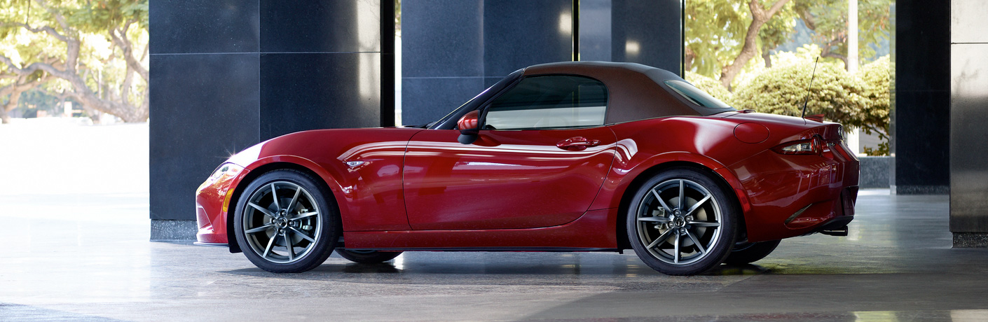 Exterior view of a red 2019 Mazda MX-5 Miata parked in a parking garage