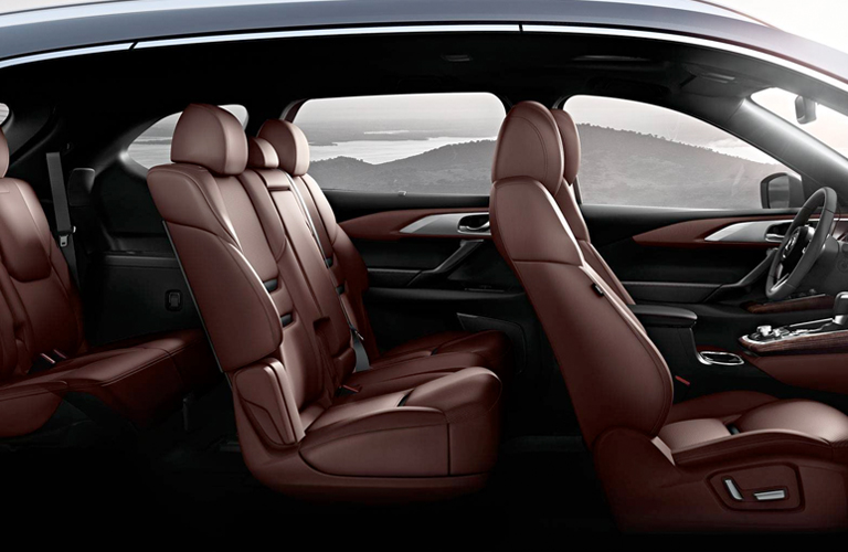 Interior view of all three rows of brown seating inside a 2019 Mazda CX-9