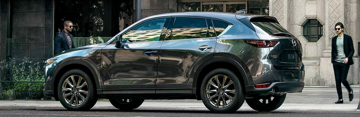Exterior view of a gray 2019 Mazda CX-5 parked on a city street