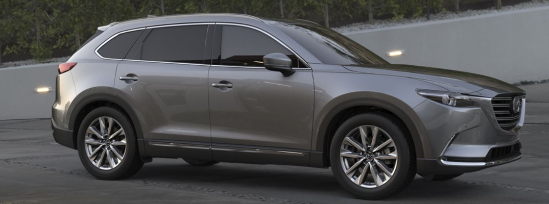 Exterior view of a grey 2019 Mazda CX-9 parked in a driveway