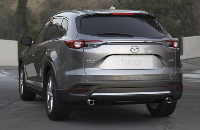 Exterior view of the rear of a gray 2019 Mazda CX-9 parked in a driveway