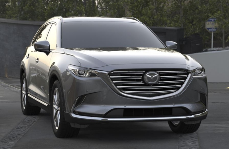 Exterior view of the front of a grey 2019 Mazda CX-9 parked in a driveway