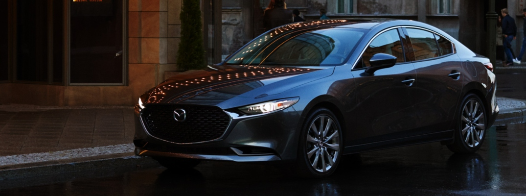 Exterior view of a black 2019 Mazda3 parked on a city street
