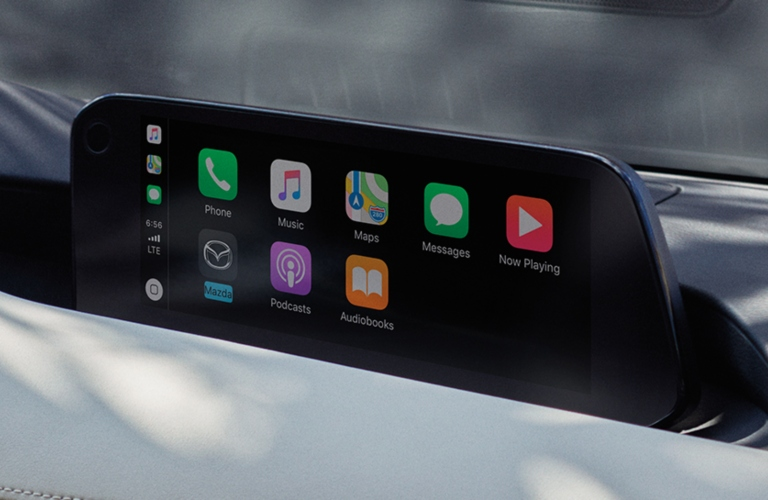 Interior closeup view of the Mazda Connect™ Infotainment System with Apple CarPlay™ on the display inside a 2019 Mazda3