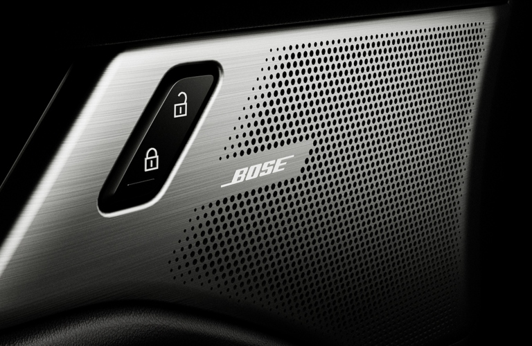 Interior closeup view of one of the 12 Bose® speakers inside a 2019 Mazda3