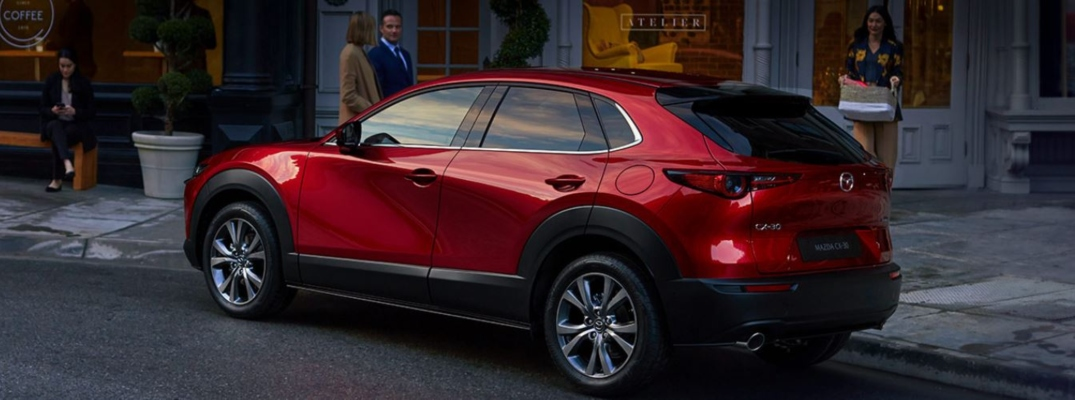 Exterior view of a red 2020 Mazda CX-30 parked on a city street