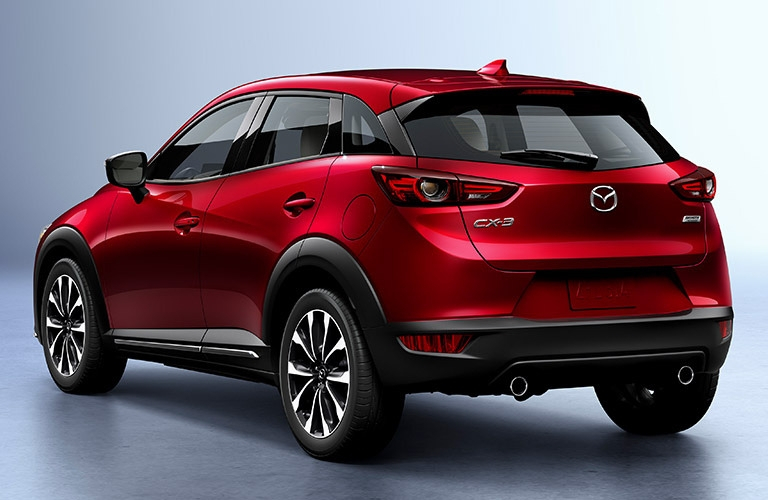Exterior view of the rear of a red 2019 Mazda CX-3 parked in a silver showroom