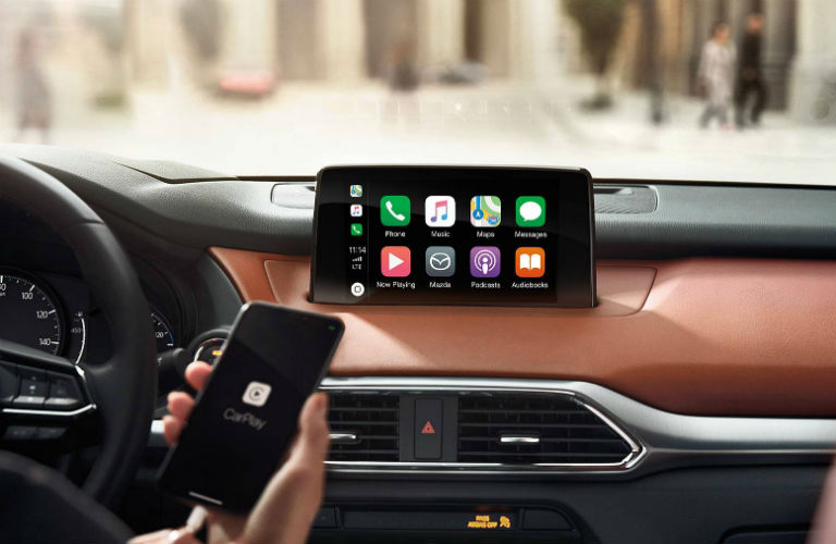 Interior view of a 2019 Mazda CX-9 focused on the MAZDA CONNECT infotainment system with Apple CarPlay on the touchscreen