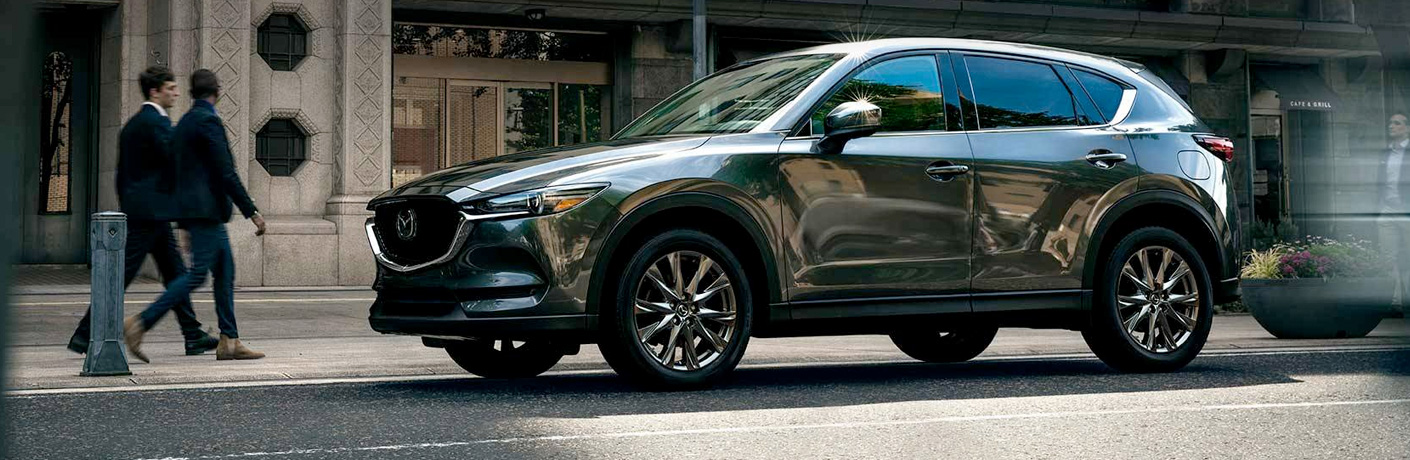 Exterior view of a silver 2019 Mazda CX-5 parked on a city street