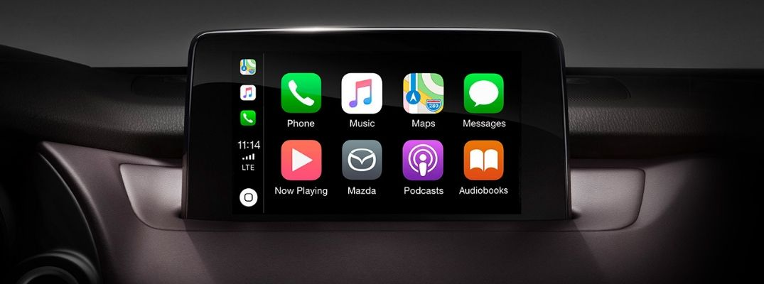 Closeup view of Apple CarPlay® on the touchscreen inside a Mazda vehicle
