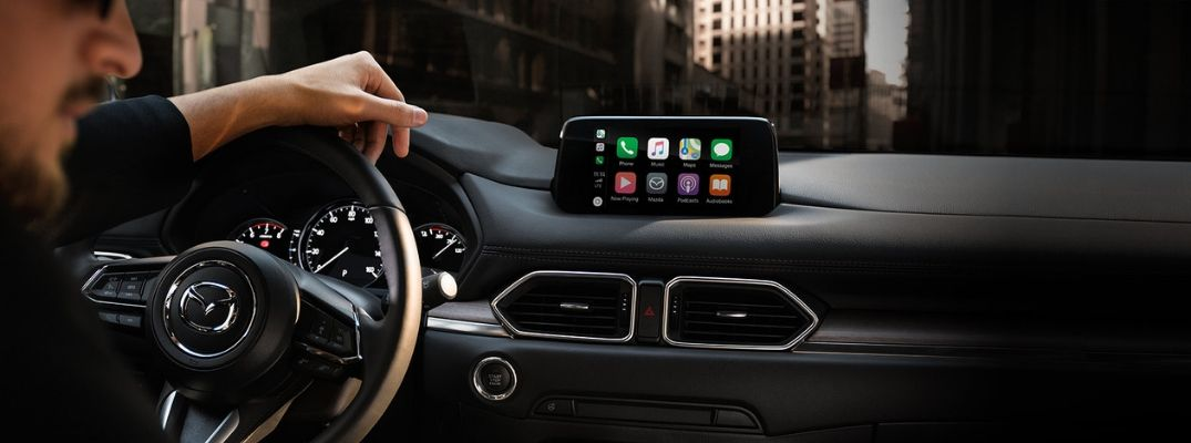 Interior view of a Mazda vehicle with Apple CarPlay® on the touchscreen display