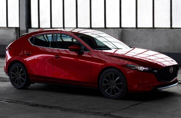 Exterior view of the passenger's side of a red 2019 Mazda3 Hatchback