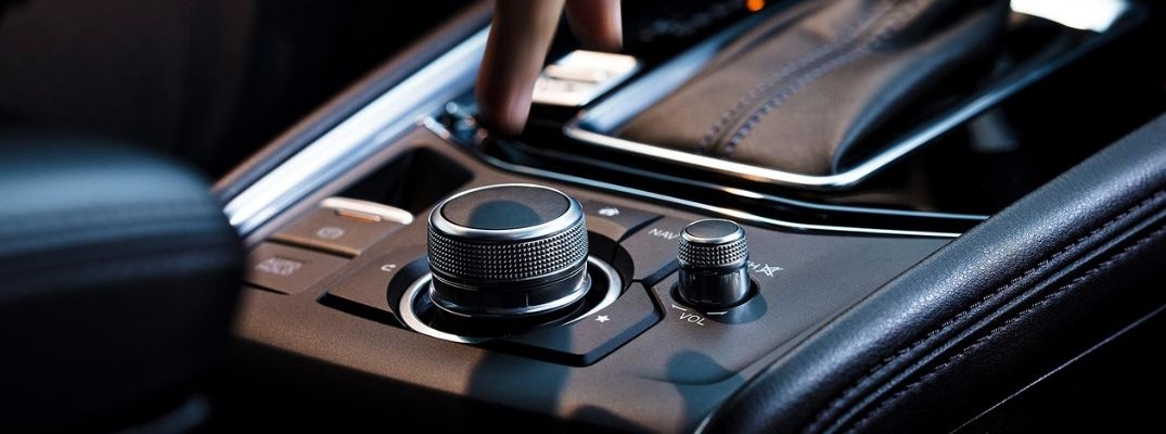 How Do You Operate the Commander Knob and Buttons in Your Mazda Vehicle?