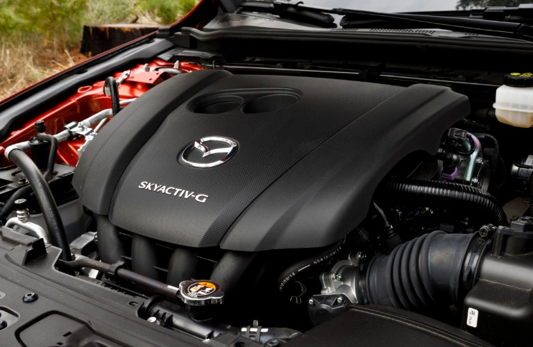 Closeup view of the SKYACTIV®-G 2.5L engine under the hood of a 2020 Mazda3 Hatchback