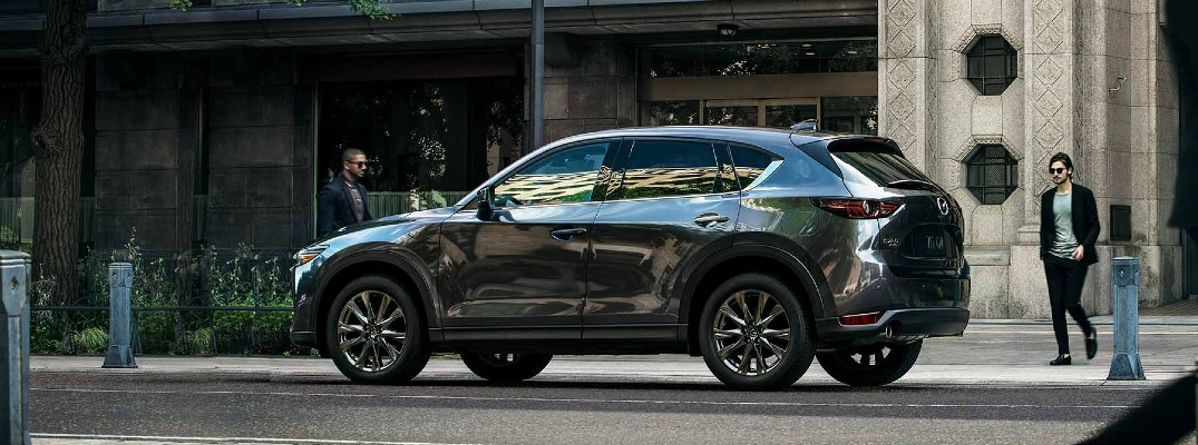 2019 mazda CX-5 Signature facing left parked by city with person walking around back