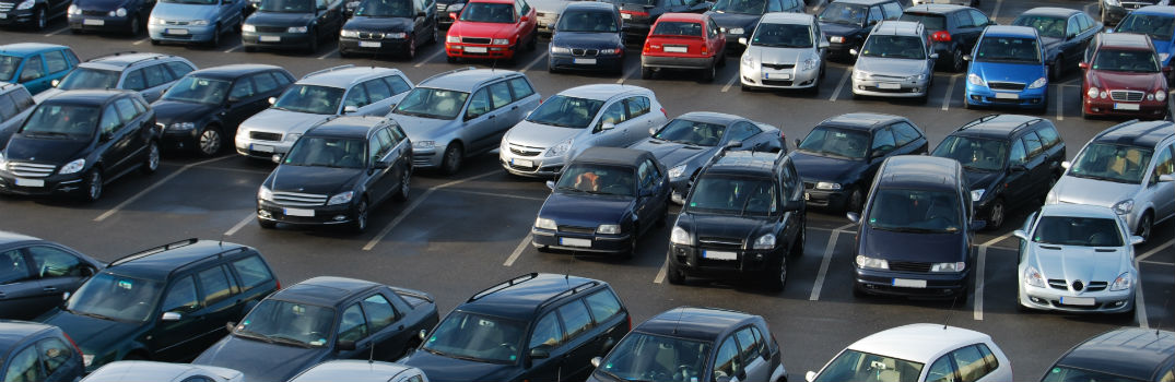large number of cars parked in a parking lot