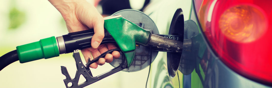 person filling car with fuel
