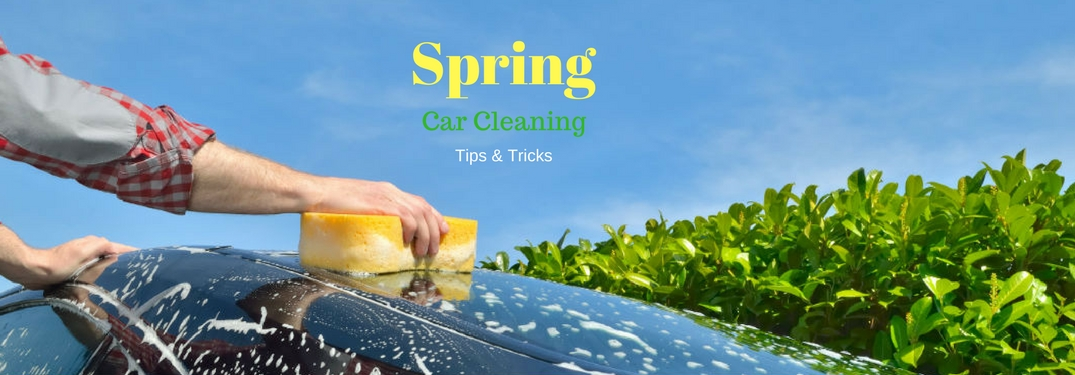 Spring Car Cleaning Tips & Tricks, text on an image of a person washing a car with a yellow sponge