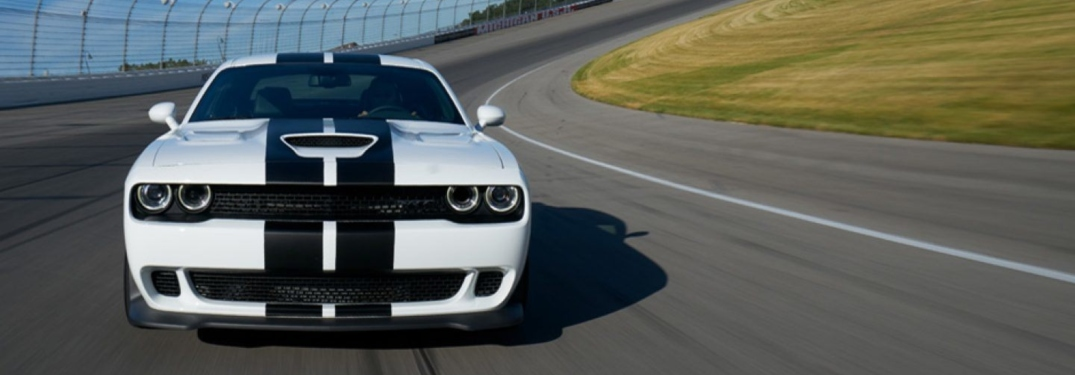 White 2018 Dodge Challenger driving on race track