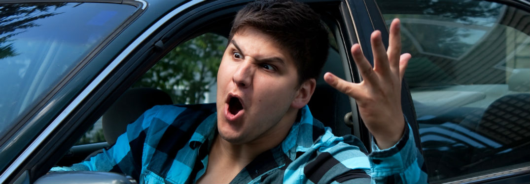man in car expressing road rage