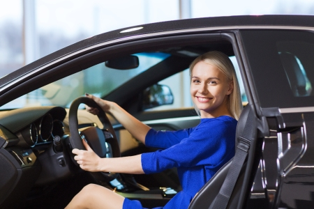 Young woman sitting in the driver's seat of a car
