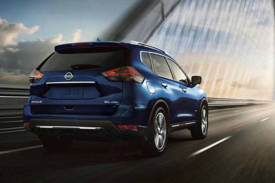 2018 Nissan Rogue Towing Capacity. 2018 Nissan Rogue In Dark Blue Driving  At Night On A Bridge
