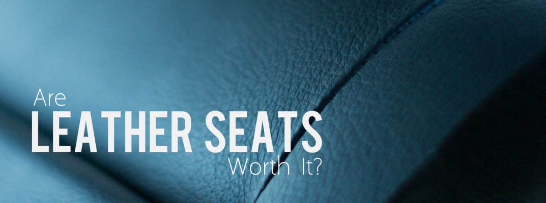 "Close up of leather seats with the words ""are leather seats worth it?"""