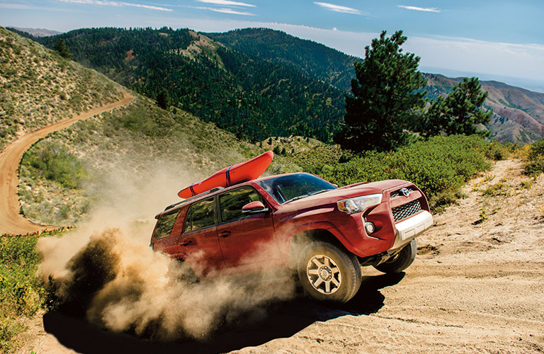 red Toyota 4Runner driving off road