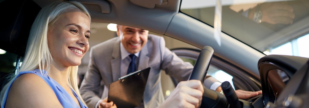 prospective car buyer sitting in driver's seat