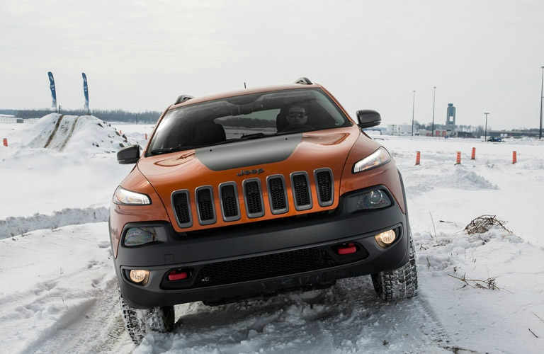 orange Jeep Cherokee front view