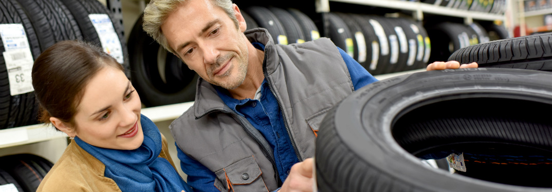 customer looking at new tires at the store