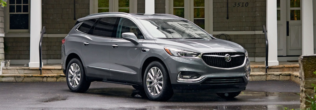 2020 Buick Enclave parked and with pillars behind it
