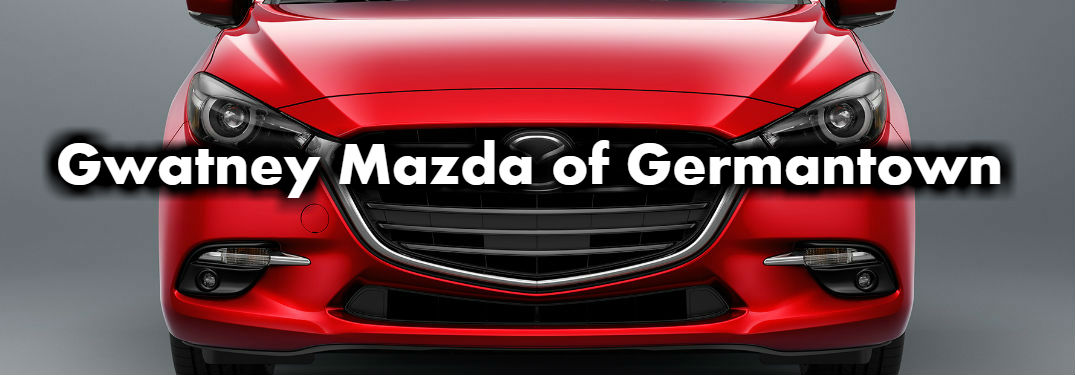 Front End View of Mazda3 in Red with Gwatney Mazda of Germantown Written on it