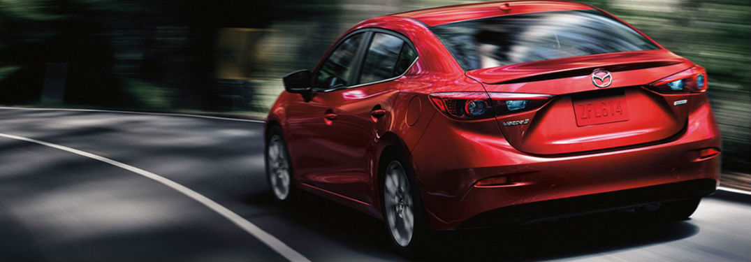 2018 Mazda3 Exterior View in Red Driving Down Road