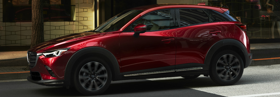 2019 Mazda CX-3 driving down street exterior driver side view