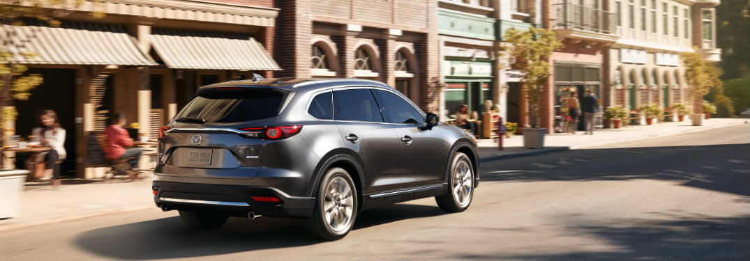 gray-2018-Mazda-CX-9-driving-along-downtown-street