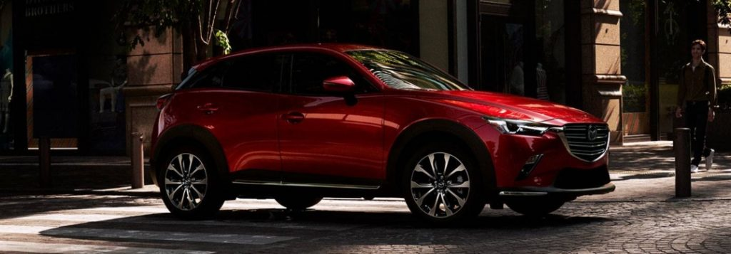 2019 Mazda CX-3 red side view on cobble stone
