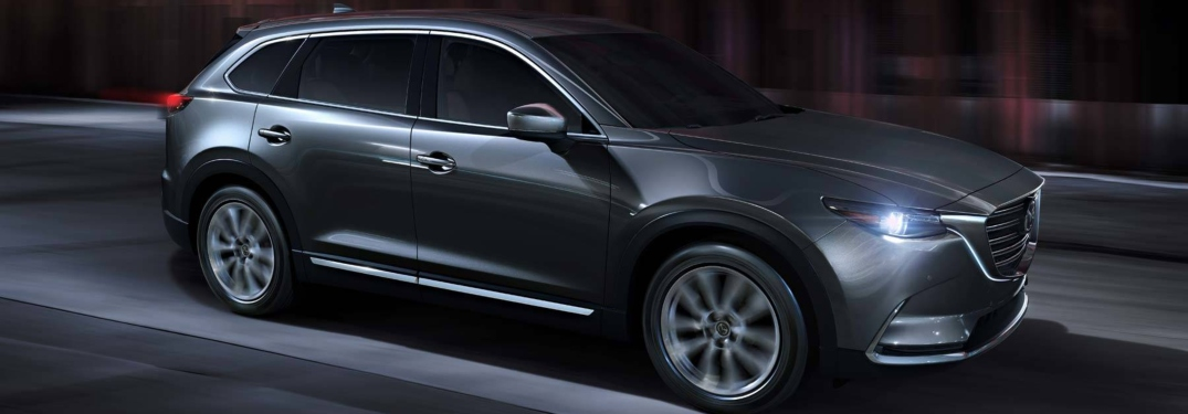2019 Mazda CX-9 gray side view at night with headlights on