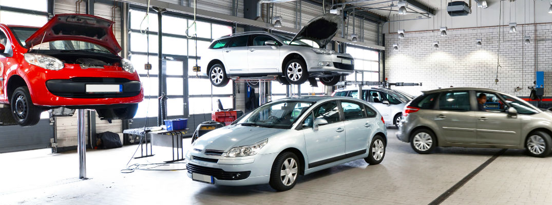 A stock photo of cars in a service department.