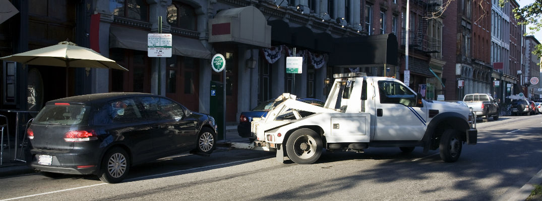 A stock photo of the a car being towed away.