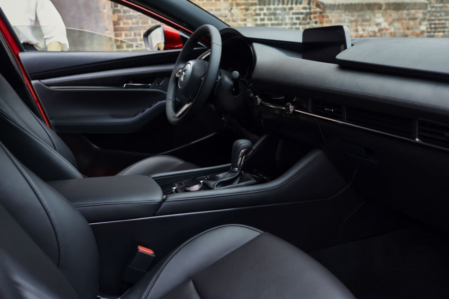An interior photo of the 2019 Mazda3 showing parts of the driver's cockpit.