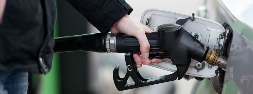 A stock photo of someone filling up their vehicle with gas.