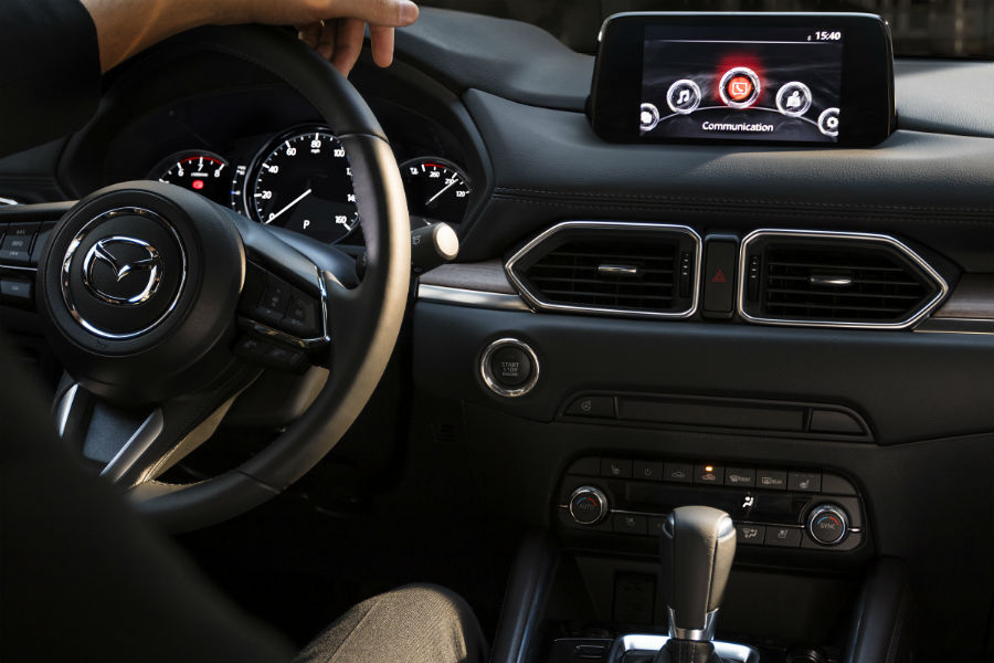 A photo of the start/stop button in the Mazda CX-5.